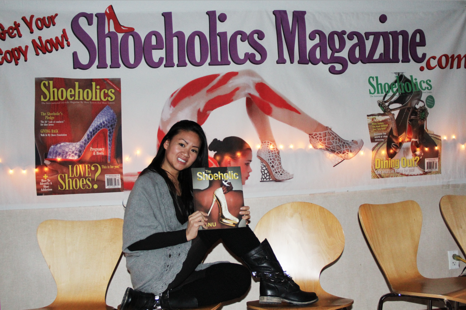 Joyce Ng with one of her winning prizes at the event. She scored a copy of The Shoeholic hardcover book!